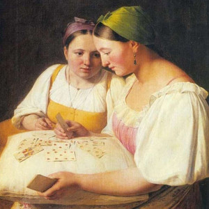 Two girls reading cards for classes page